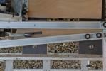 """Une pièce comme cette """"clé"""", moins large, est toujours réalisable à condition d'interposer une bande de bois aux bords parallèles entre la règle mobile et la pièce."""